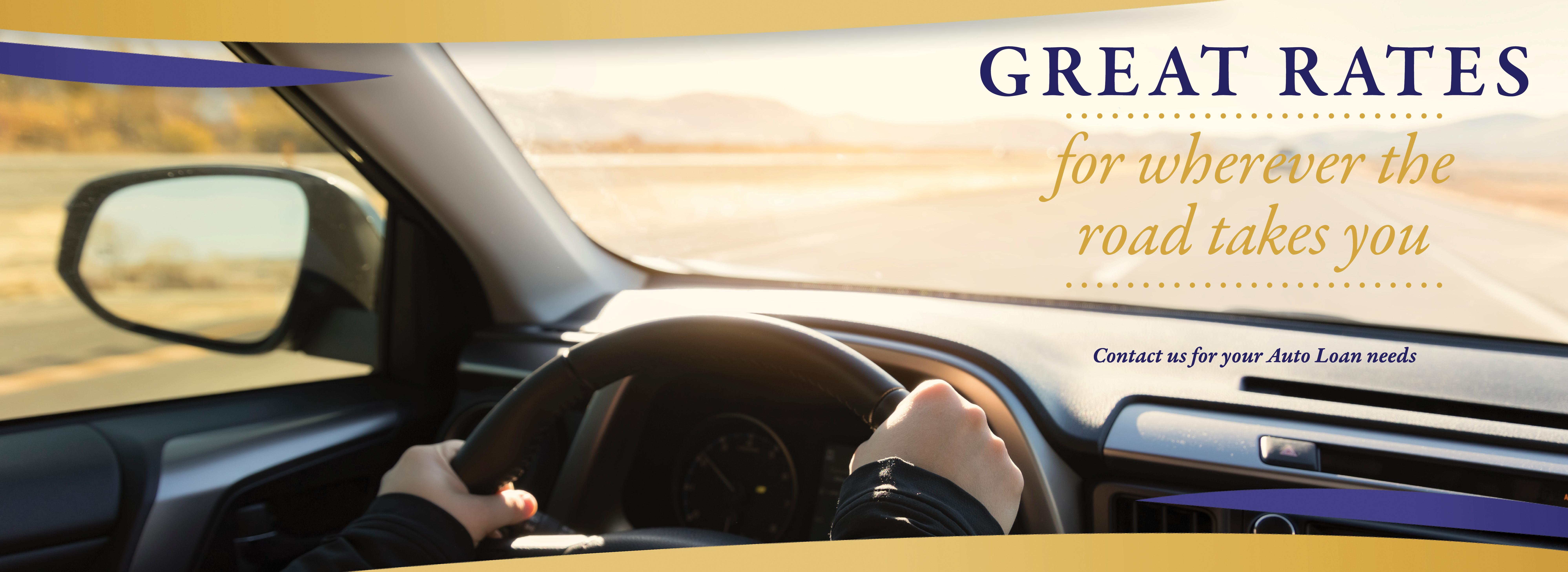 Great Rates... for wherever the road takes you.  Contact us for your Auto Loan needs.  Image of interior of a vehicle of someone driving down a highway.